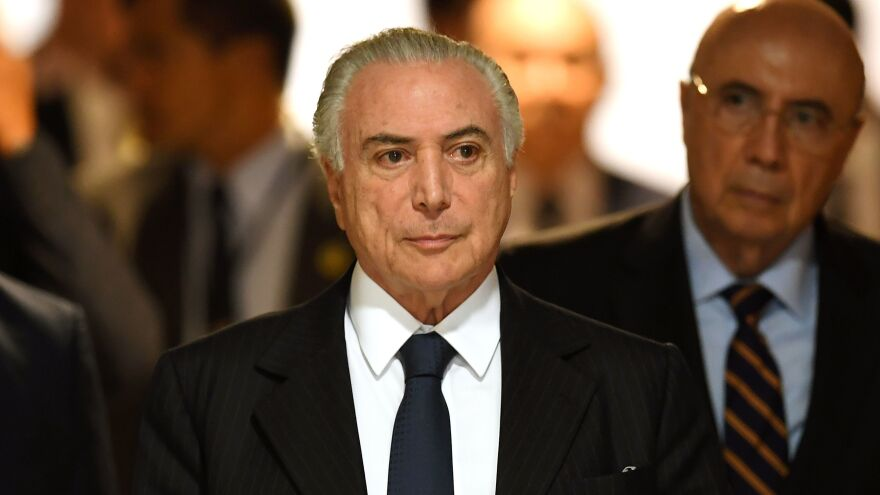 Brazilian President Michel Temer arrives at a signing ceremony in Brasilia on Monday. The country's prosecutor general has requested formal corruption charges against Temer.
