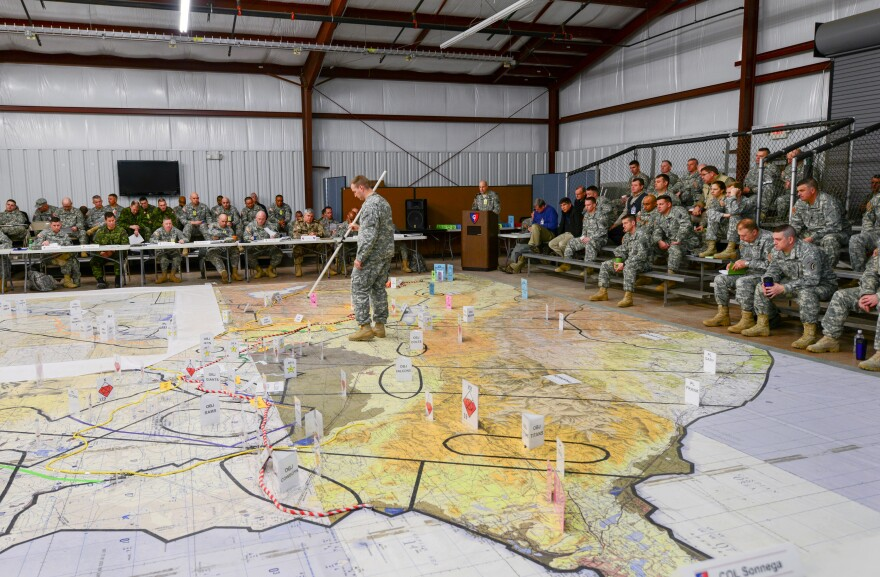 Service members at a 2015 war-fighter exercise participate in a combined arms rehearsal at Camp Atterbury and Muscatatuck. The Indiana National Guard is hoping its base will continue to serve organizations that need training facilities.
