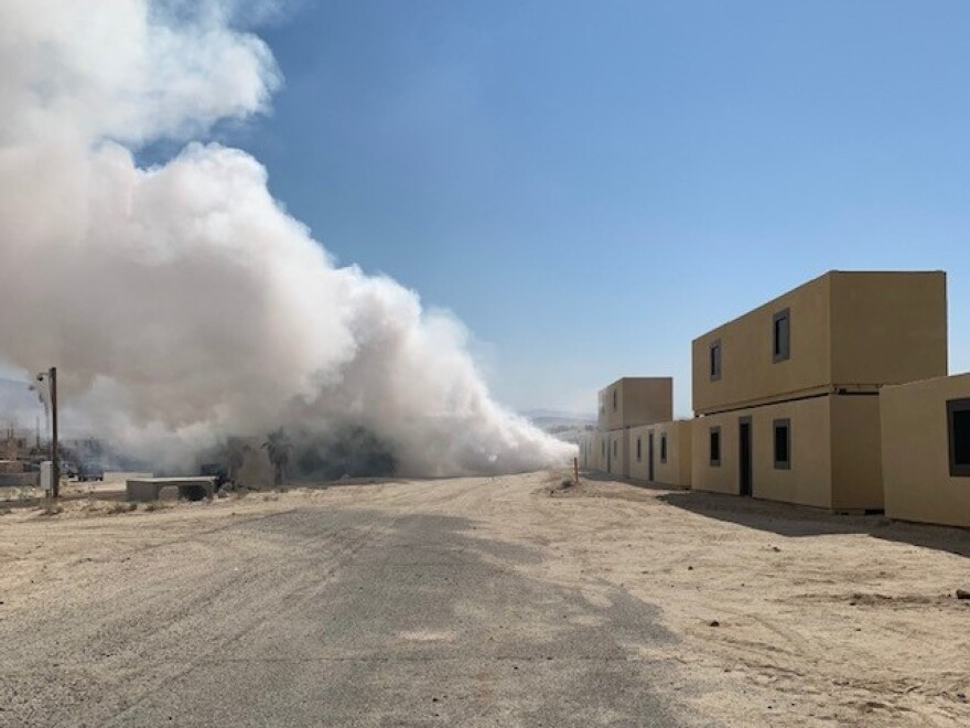 Smoke billows up at the mock village of Seize Razish.