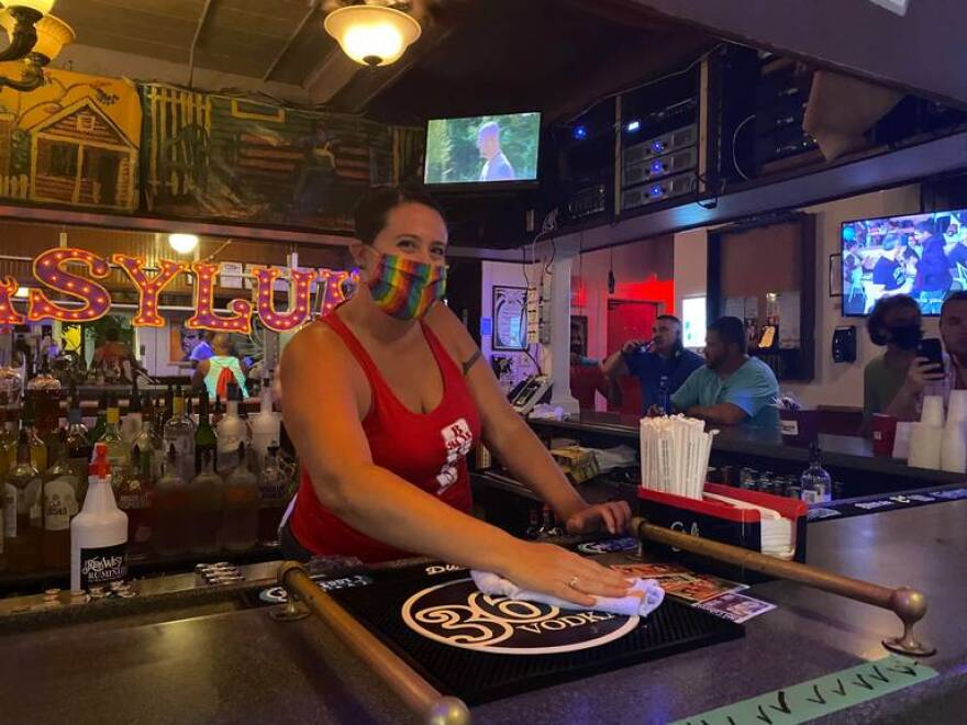 Erinn Harrelson tends bar at the 801 Bourbon Bar in Key West early Friday morning, when bars were allowed to reopen.