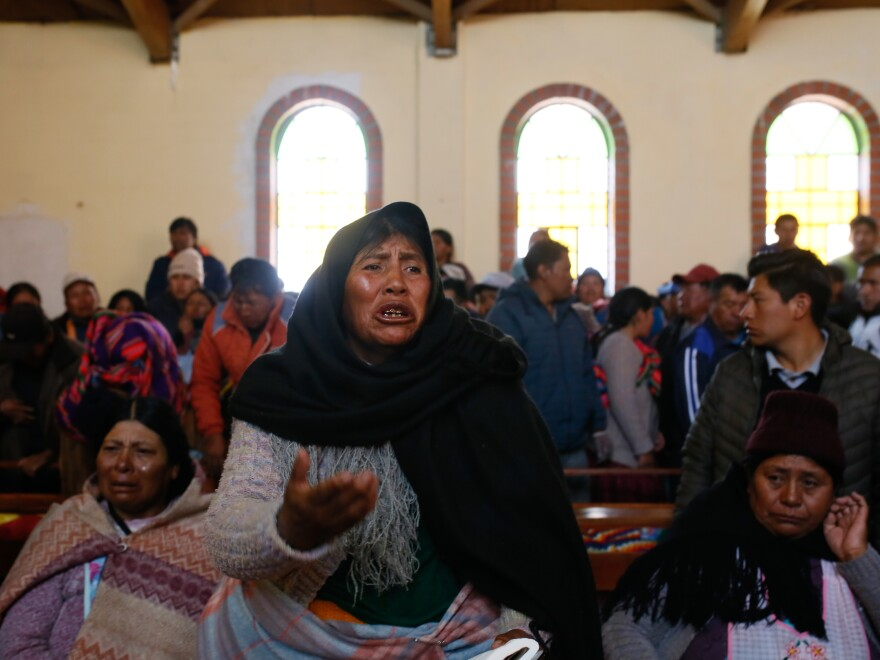 Mourners lament the deaths of young men at a funeral in El Alto, Bolivia, on Wednesday. The men were shot outside a major fuel plant in an operation by Bolivian security forces to clear a blockade that has caused fuel shortages in La Paz.