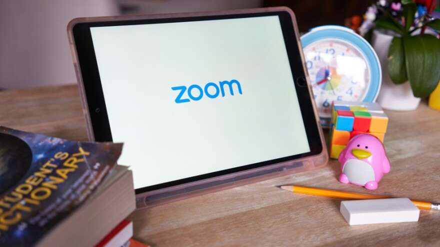 tablet with Zoom video conferencing software