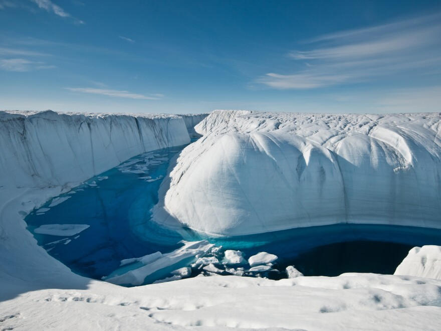 For several summers this deeply incised melt channel transported overflow from a large melt lake to a moulin, a conduit that drains the water through many hundreds of feet to the ice sheet's bed.