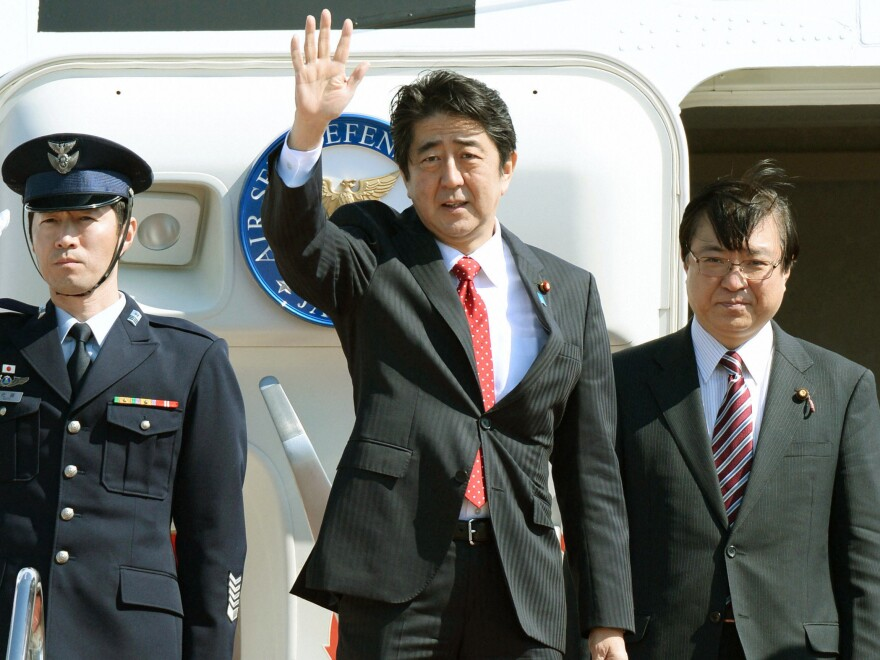 Japan's Prime Minister Shinzo Abe leaves Tokyo's Haneda airport Sunday en route to a two-day nuclear security summit in The Hague, Netherlands.