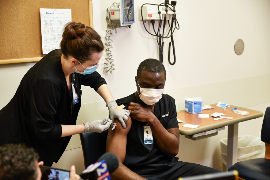 Nurse Ben Ojie was among the first in the St. Louis region to receive a coronavirus vaccination. Ojie works works in the COVID-19 unit at Mercy South Hospital in south St. Louis County. Monday, December 14, 2020.