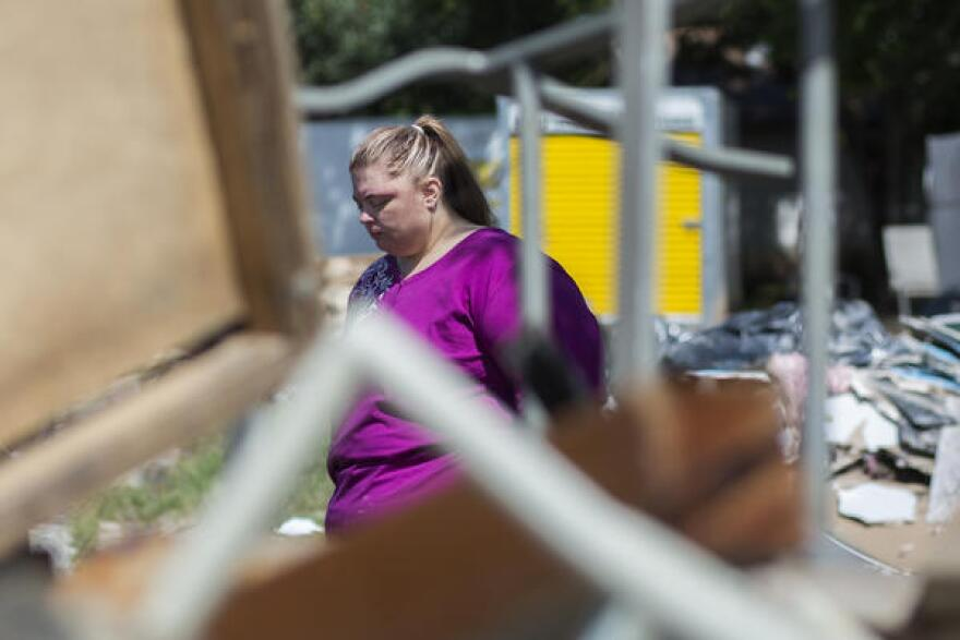 April Marshall, the sister of Andy Creed's girlfriend, surveys the damage to her home.