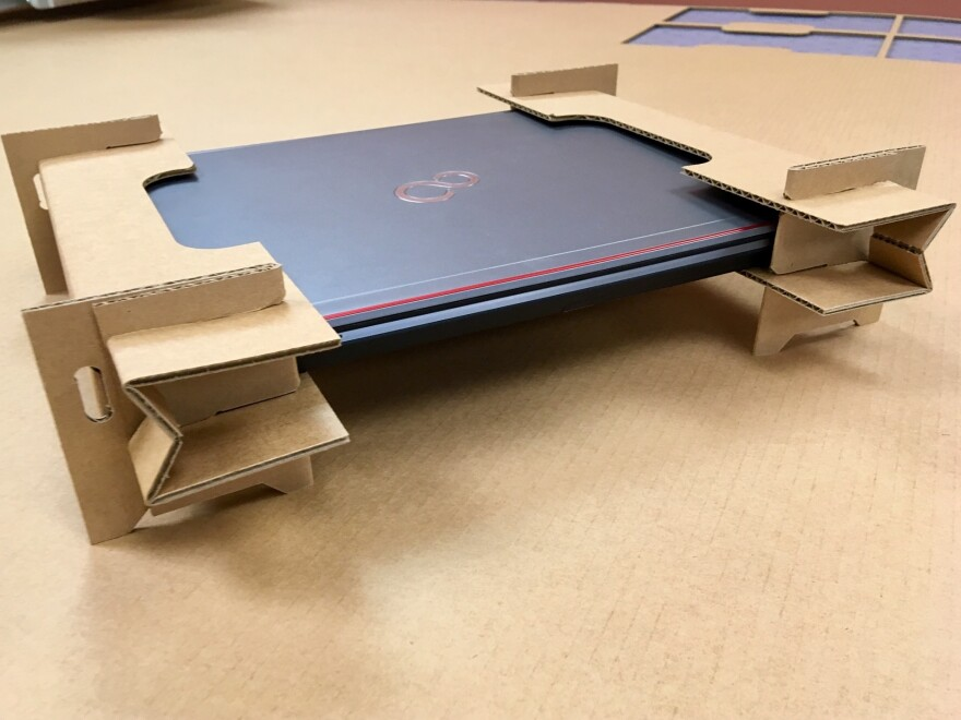 These cardboard cutouts are designed to replace the plastic foam end caps companies use to ship laptop computers.