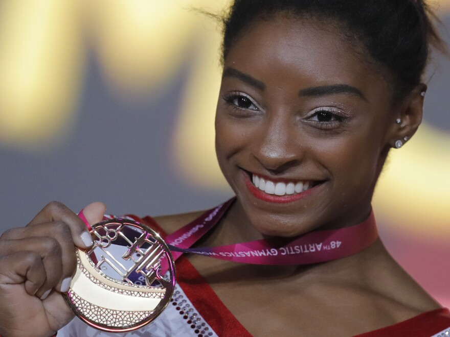 Simone Biles of the U.S. shows her gold medal after the women's vault final at the gymnastics World Championships in Doha, Qatar, last week.