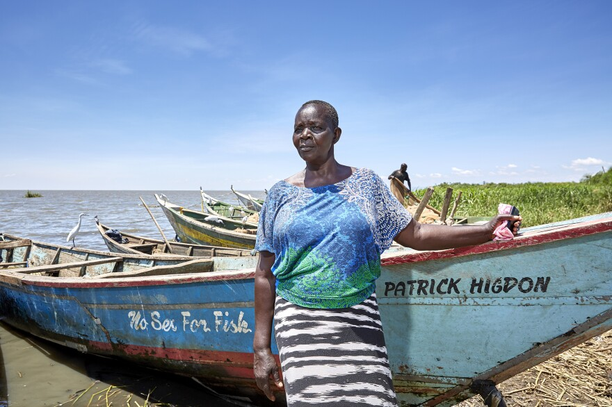 Justine Adhiambo Obura is a leader in the No Sex For Fish program. She stands in front of one of the 30 boats that were obtained for local women with grant money, so they could own their own vessels and hire men to fish for them. The goal is to stop the practice of fishermen demanding sex in exchange for entrusting their catch to a woman fishmonger to sell.