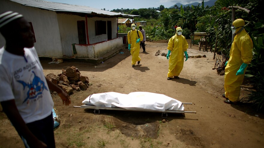 The authorities in Sierra Leone are coping with a raging Ebola epidemic in Freetown (above) yet they must also keep constant watch for Ebola hot spots that may crop up in the countryside.