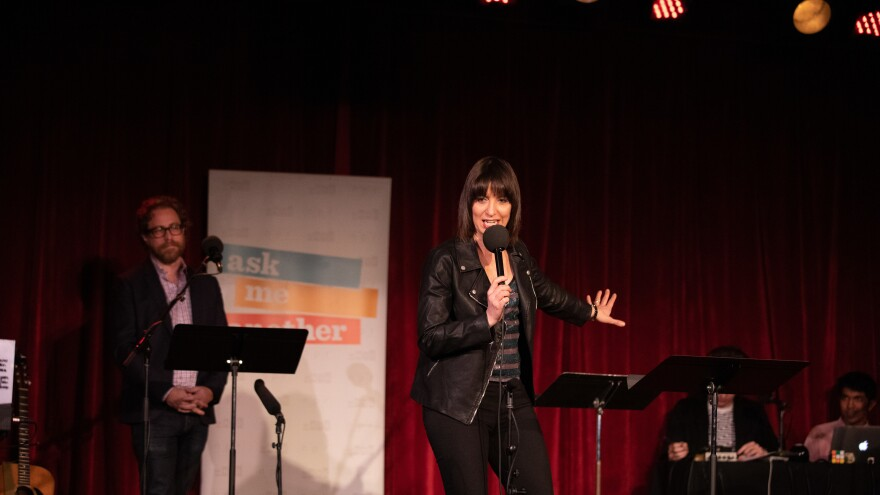 Ophira Eisenberg performs stand-up on <em>Ask Me Another</em> at the Bell House in Brooklyn, New York.