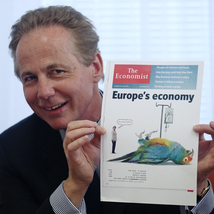 Georg Kapsch, President of the Federation of Austrian Industry, holds an issue of <em>The Economist</em> during a news conference in Vienna last year. Britain's Pearson PLC says it's in talks to sell its 50 percent share in The Economist Group.