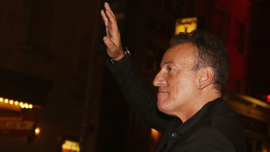 Bruce Springsteen greets the crowd assembled outside of the Water Kerr Theatre in Manhattan on Oct. 12, 2017, for the opening night of <em>Springsteen on Broadway.</em>