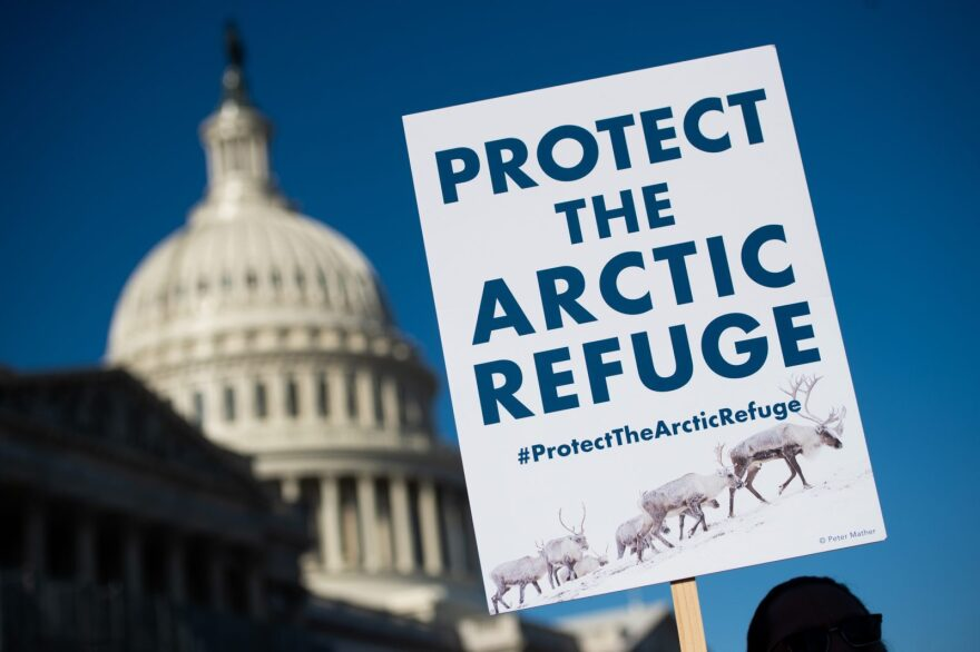A demonstrator holds a sign against drilling in the Arctic Refuge on the 58th anniversary of the Arctic National Wildlife Refuge, during a press conference outside the US Capitol in Washington, DC.