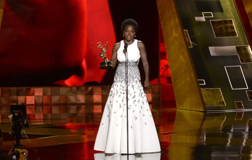 Viola Davis accepts the Emmy for outstanding lead actress in a drama series for <em>How to Get Away With Murder</em> at the 67th Primetime Emmy Awards on Sunday in Los Angeles.
