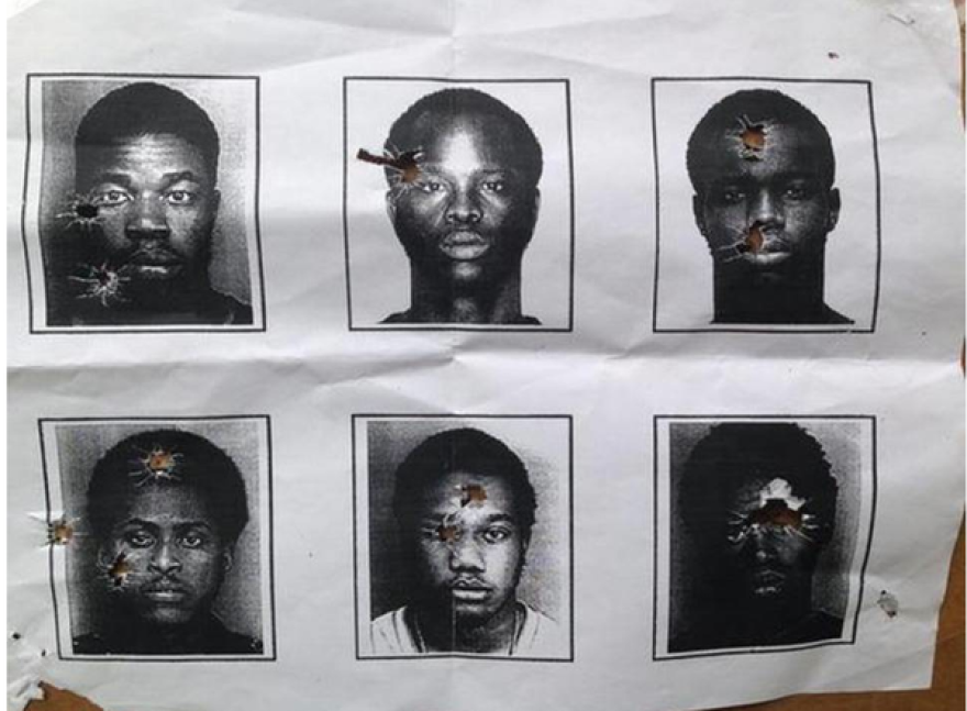 Bullet riddled target sheet shows mugshot black men arrested by North Miami Beach police.