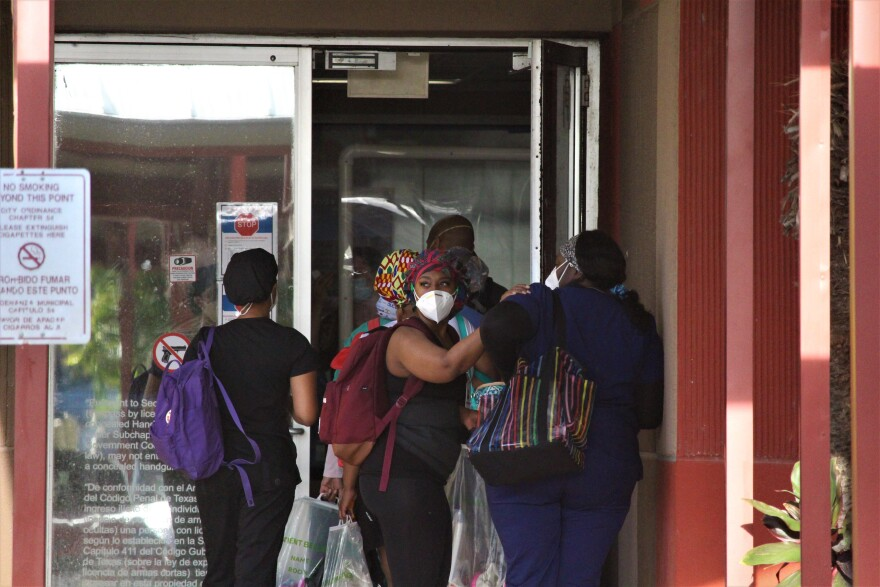 Healthcare workers enter the McAllen Medical Center for an overnight shift.