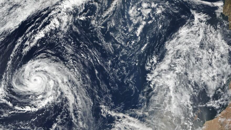 This satellite image taken Friday shows Ophelia churning a path across the Atlantic Ocean, heading northeastward.
