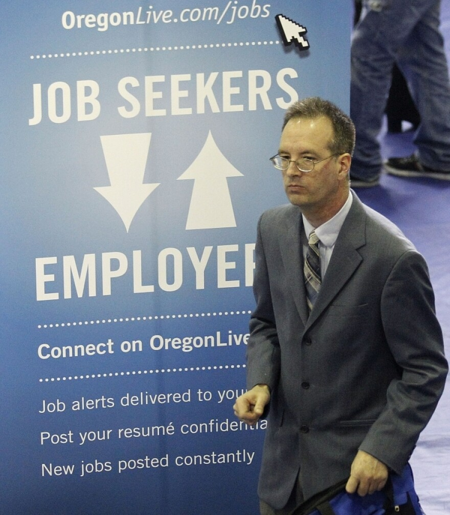 Don Meikle attends an April job fair in Portland, Ore. A new poll shows the economy remains the most important factor for Americans in deciding who to back for president, but with adults split over who would best lead the U.S. economy.