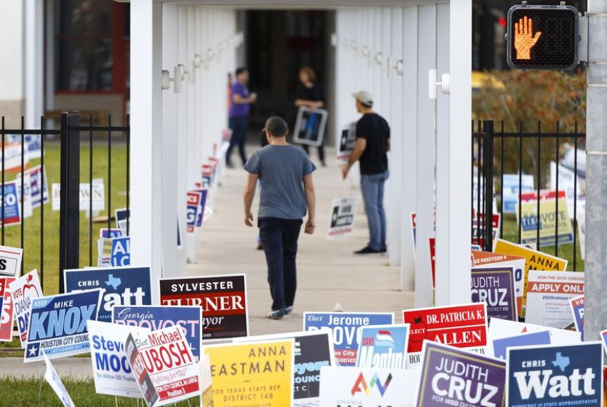 Campaign workers outside a polling place in Houston