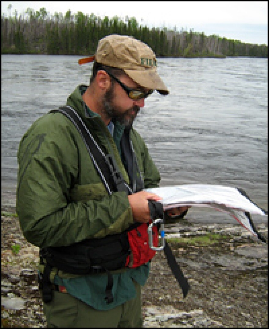 Phil Royce, an outdoor guide and geologist from St.  Lawrence University, charts the next set of rapids on the Rupert River.