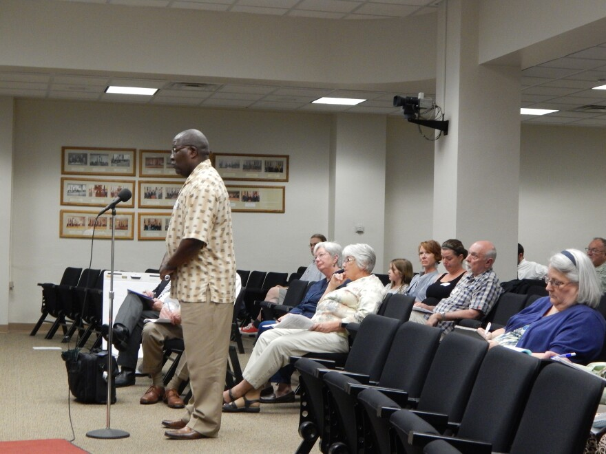Jeffrey Simmons speaks to representatives from the City of Dayton water department.