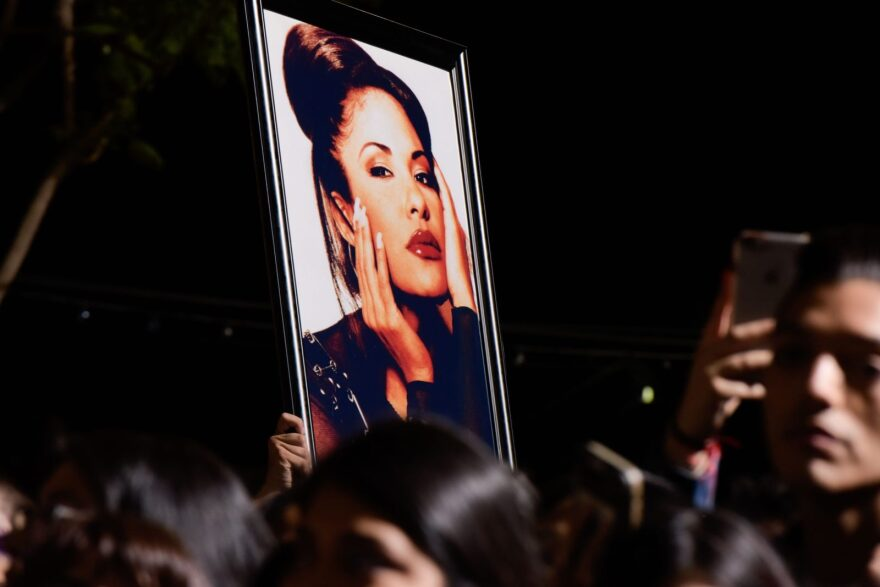 Fans hold a photo of Selena Quintanilla during a ceremony honoring the singer in Hollywood, California.