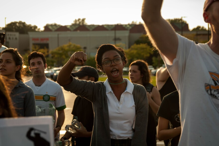 A demonstrator leads a cheer as protesters block Brentwood Blvd. and shut down the Galleria mall Wednesday, Sept. 20, 2017.