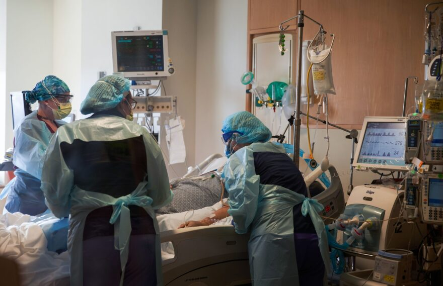 Nurses care for a COVID-19 positive patient at UMass Memorial Hospital on Dec. 4, 2020 in Worcester, Massachusetts. (Allison Dinner/AFP/Getty Images)