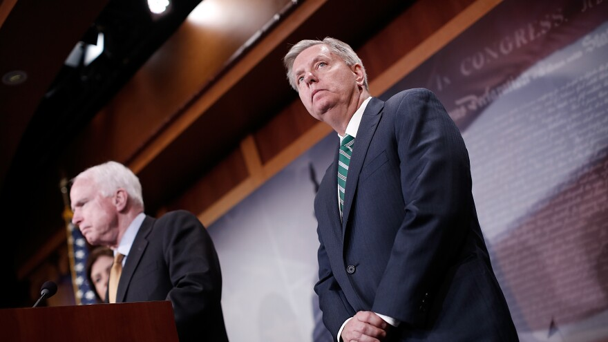 """Sens. John McCain and Lindsey Graham in 2015. """"President Trump confronted a pivotal moment in Syria and took action,"""" they said in a statement."""
