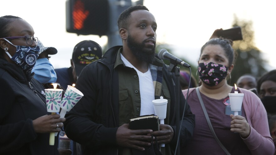 Matthew Ellis speaks at a vigil at the intersection where his brother, Manuel Ellis, a 33-year-old black man, died in police custody in Tacoma, Wash. Ellis's death was ruled a homicide this week by the Pierce County Medical Examiners Office.