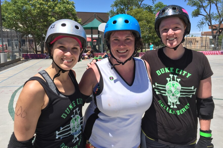 Lauren Winkler, Leigh Featherstone and Holly Chamberlin, left to right, all supporters of Hillary Clinton, at a roller derby scrimmage in Albuquerque, N.M.