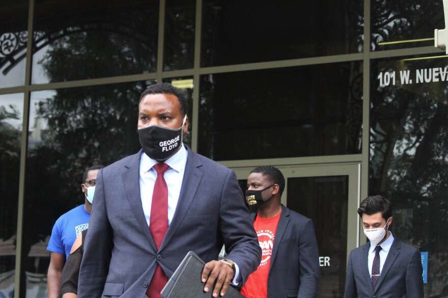 Attorney Lee Merritt exits the Paul Elizondo Tower after meeting with the Bexar County DA.