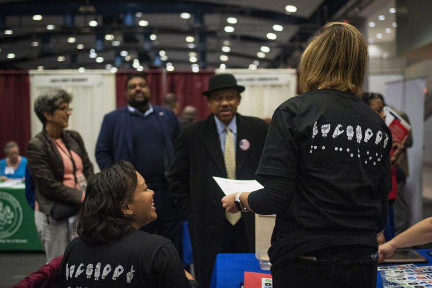 Job candidates with disabilities attend <em>Careers & the Disabled </em>magazine's career expo hosted by Equal Opportunity Publications in Washington, D.C.