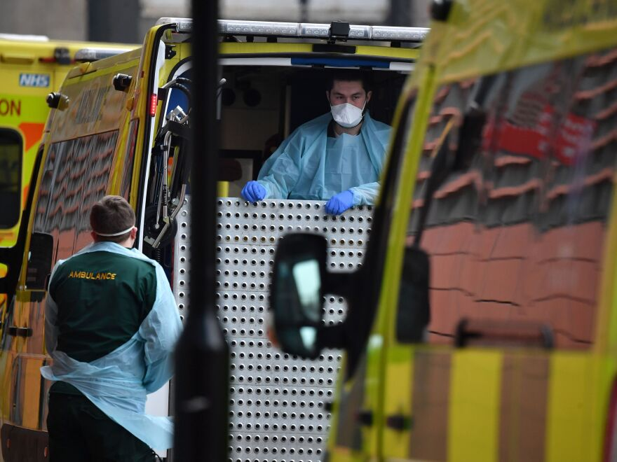 Paramedics prepare an ambulance outside the Royal London Hospital in East London on Friday. London Mayor Sadiq Khan has declared a 'major incident,' warning that hospitals in the British capital could soon be overwhelmed after a surge in coronavirus infections.