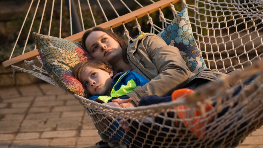 Ma (Brie Larson) snuggles with her son Jack (Jacob Tremblay) in <em>Room.</em>