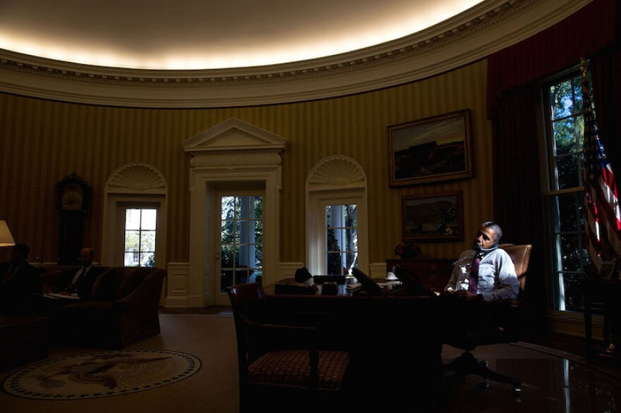 President Obama's foreign policies have come into question as of late. Here he sits in the oval office on a phone call.