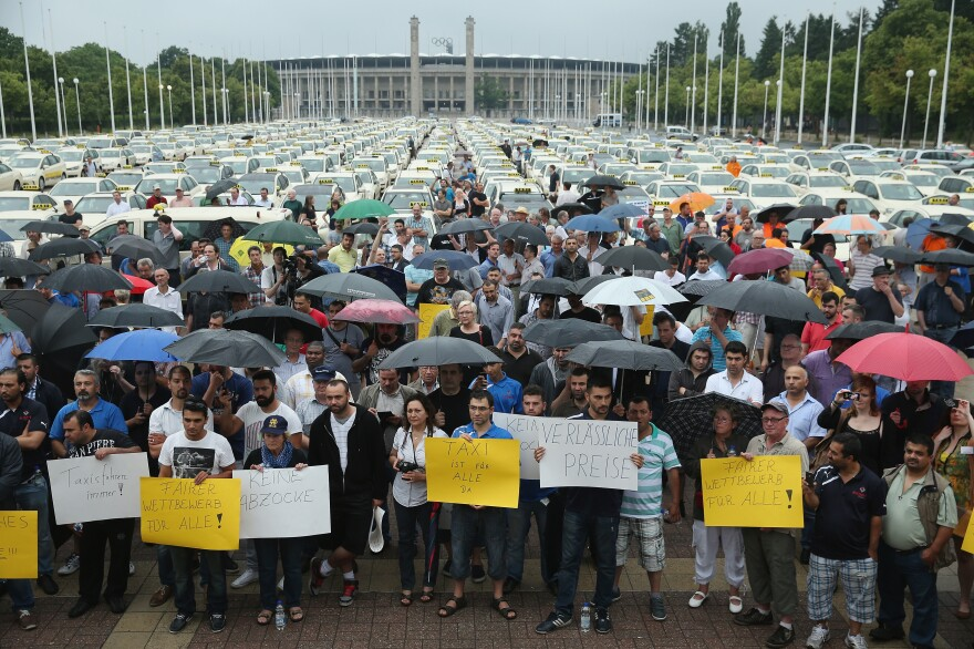 About 1,000 taxi drivers were expected during the protest Wednesday in Berlin. Here, demonstrators gather near Olympia Stadium.