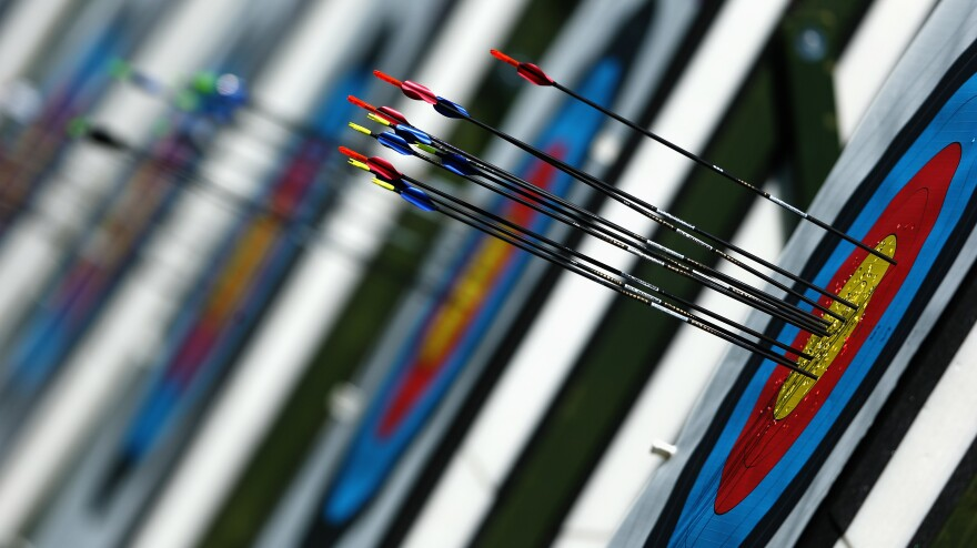 Inspired by the movie <em>Robin Hood</em>, Olympic sound man Dennis Baxter places microphones along the path to the target to capture the sound of arrows in flight.
