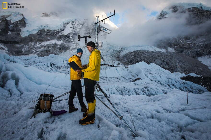 Dr. Tom Matthews and Dr. Baker Perry, members of the National Geographic and Rolex Perpetual Planet Extreme Expedition to Mt. Everest, work on the automated weather station at Everest Base Camp.