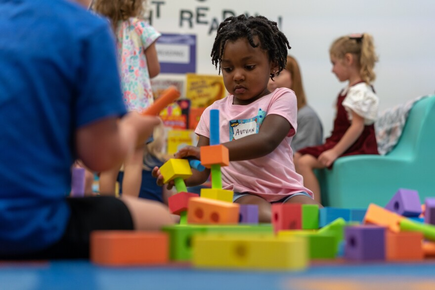 Autumn Baker plays after being dropped off for her first day of pre-K in Affton Tuesday, Aug. 13, 2019.