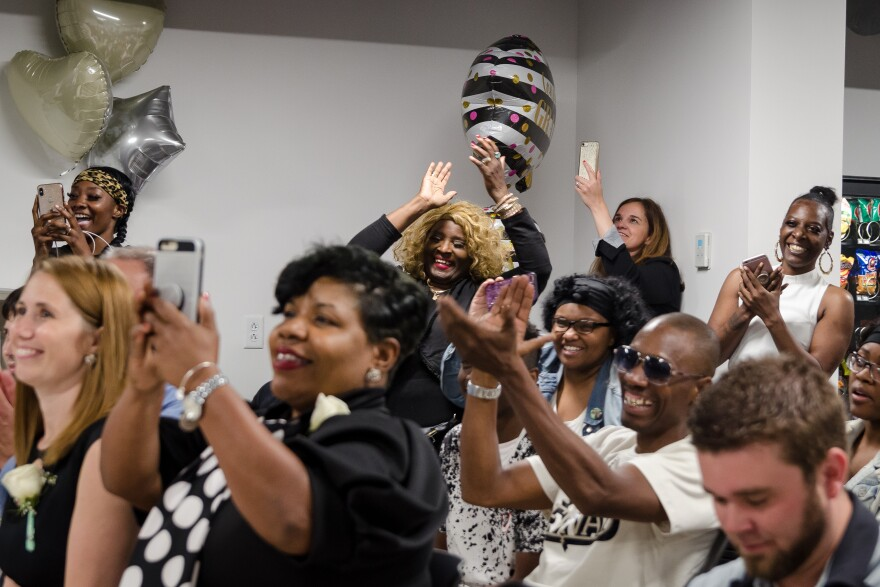 Family and MERS Goodwill staff cheer on graduates from a new adult high school program run by the non-profit May 29, 2019. About 500,000 Missourians lack a high school diploma.