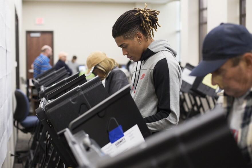 Cornell Young, 18, of Kirkwood, votes at the St. Louis County Board Of Elections on Oct. 25, 2018.