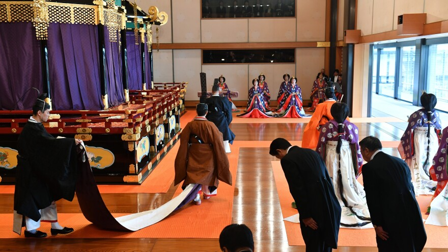 Japan's Emperor Naruhito, center, leaves the state room at the end of the enthronement ceremony where he officially proclaimed his enthronement, at the Imperial Palace in Tokyo, on Tuesday.