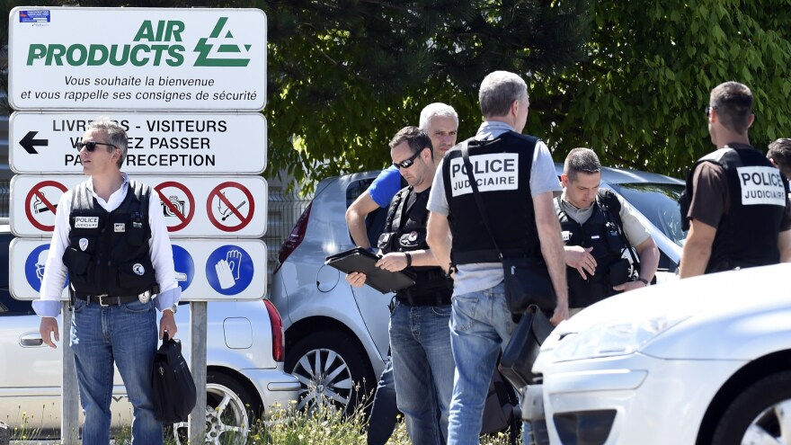 French police secure the entrance of the Air Products factory in Saint-Quentin-Fallavier, near Lyon. A decapitated body was found outside the factory.