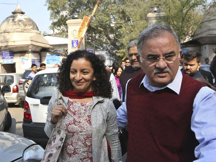 Indian journalist Priya Ramani, left, smiles as she leaves Patiala House Court in New Delhi in 2019. A New Delhi court on Wednesday acquitted Ramani of criminal defamation after she accused a former editor-turned-politician and junior external affairs minister, M.J. Akbar, of sexual harassment.