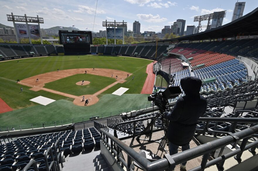 Professional sport returned to South Korea on April 21 as coronavirus restrictions ease, with the first pitch thrown in a baseball preseason derby in front of empty stands. (Jung Yeon-je /AFP via Getty Images)