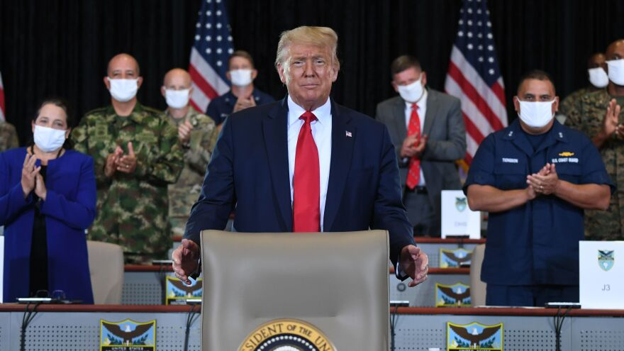 President Trump attends a briefing Friday at U.S. Southern Command in Doral, Fla.
