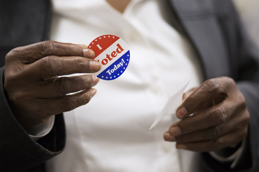 "Voters pick up ""I voted today"" stickers at the St. Louis County Board Of Elections on Oct. 25, 2018."