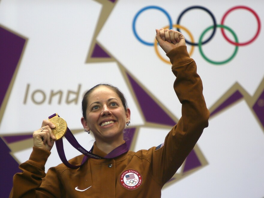 American gold medalist Jamie Lynn Gray celebrates on the podium after winning the 50m rifle 3 positions women final at the Royal Artillery Barracks in London.